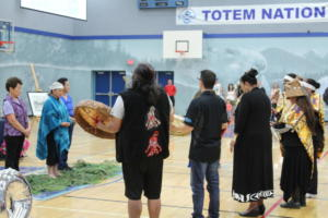 Kwantlen First Nation drummers and LouAnn Neel.